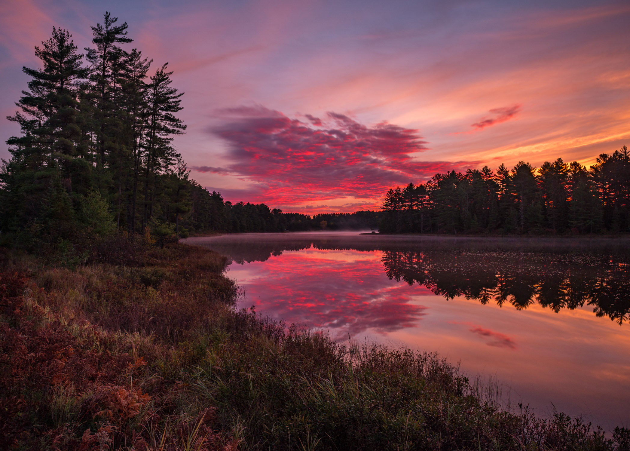 Sun rises over the campgrounds at Mew Lake, Algonquin Park, Ontario in fall.