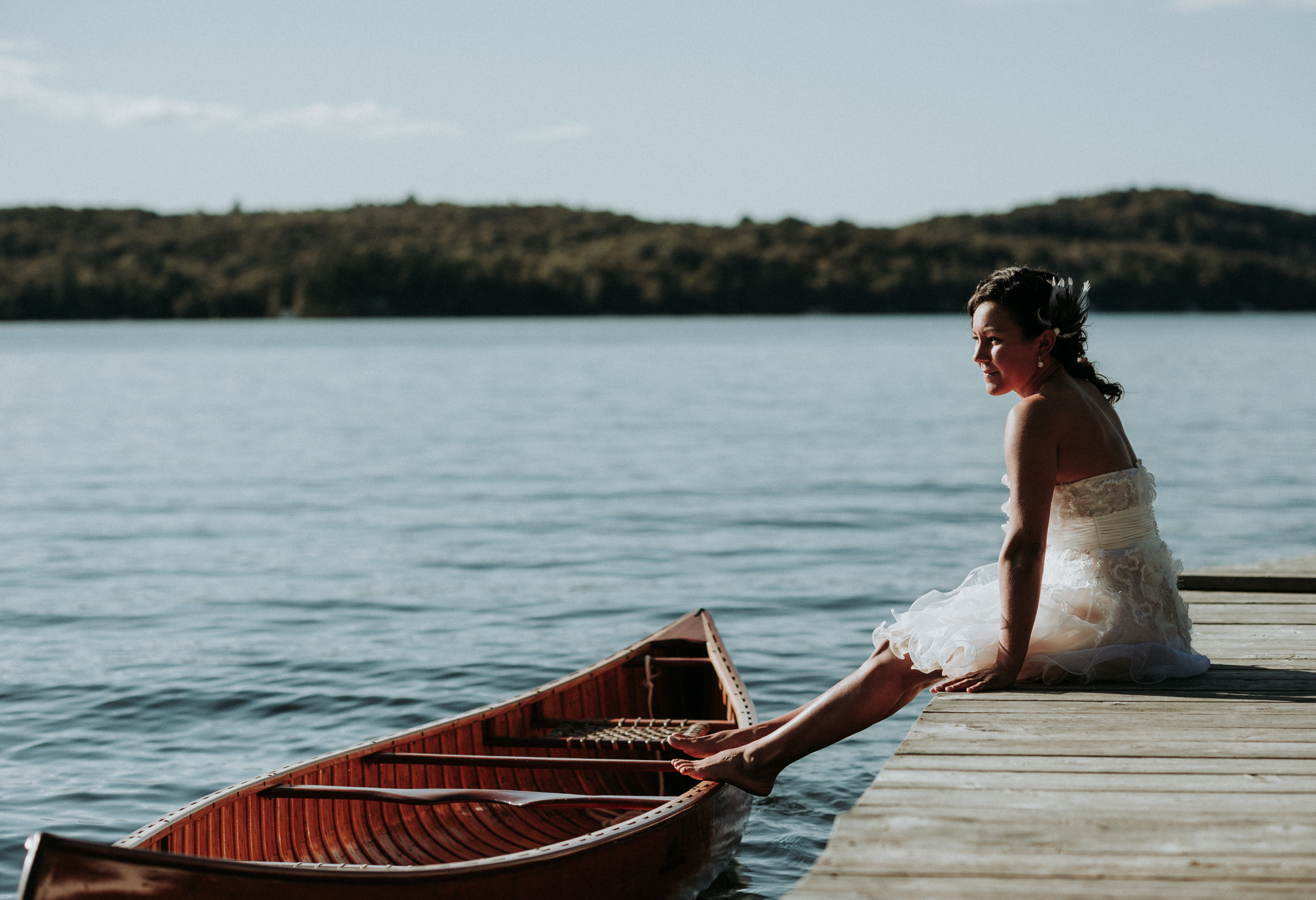 Chloe and her canoe on the dock before paddling into the cottage wedding ceremony on Lake of Bays