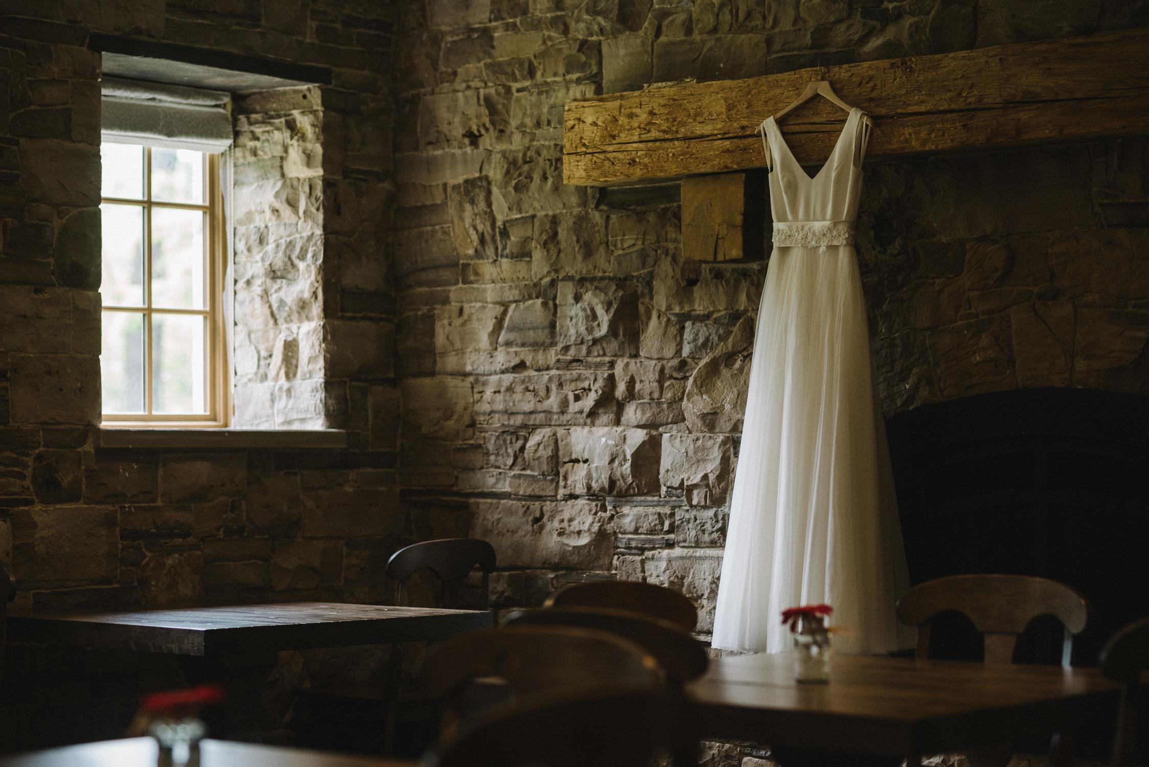 Wedding Dress hanging in The Barracks Inn, Ancaster, Ontario | Andrew + Kelsey