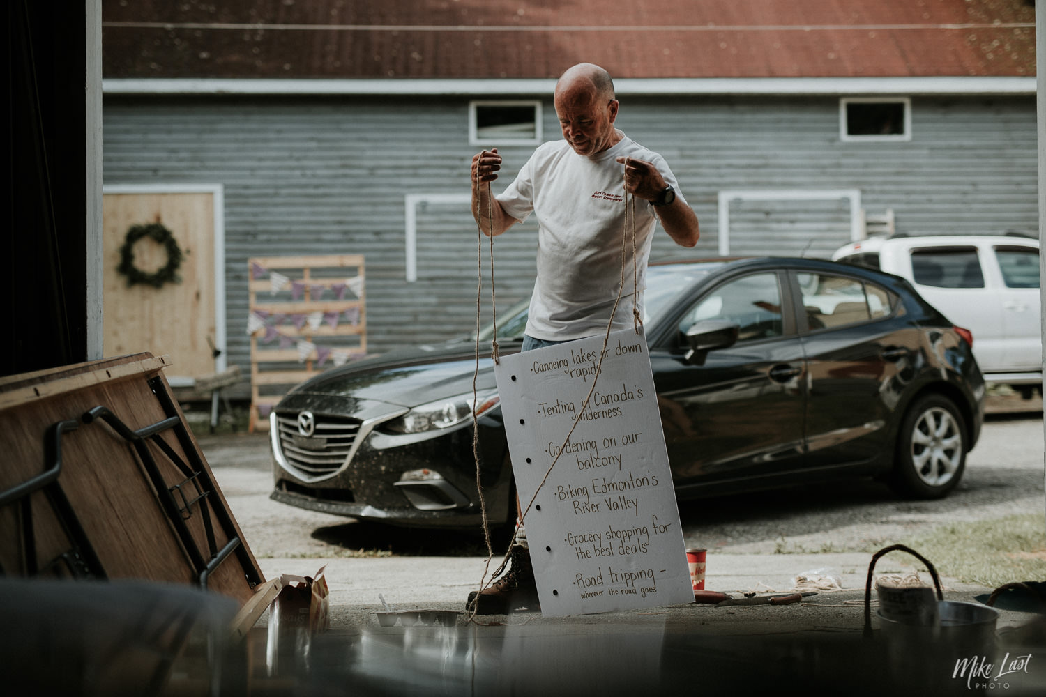 Father of the bride prepares sign for wedding in Liverpool, Nova Scotia