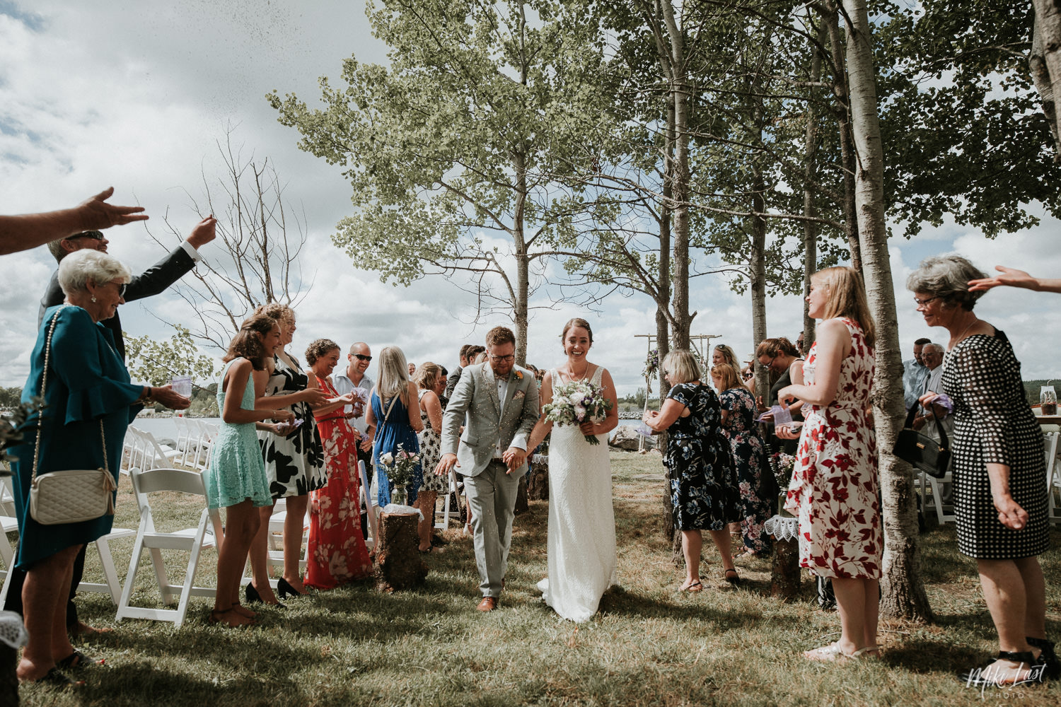 Wedding recessional with bird seed.