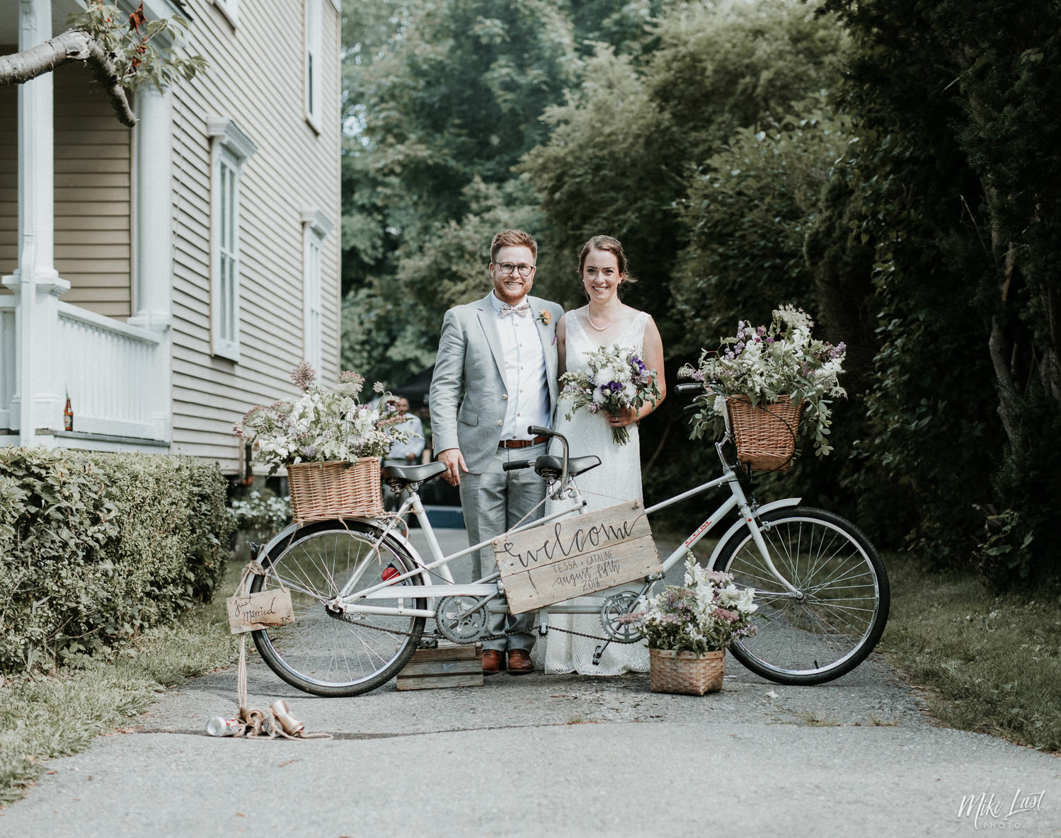 Bride and groom with a tandem bicycle.