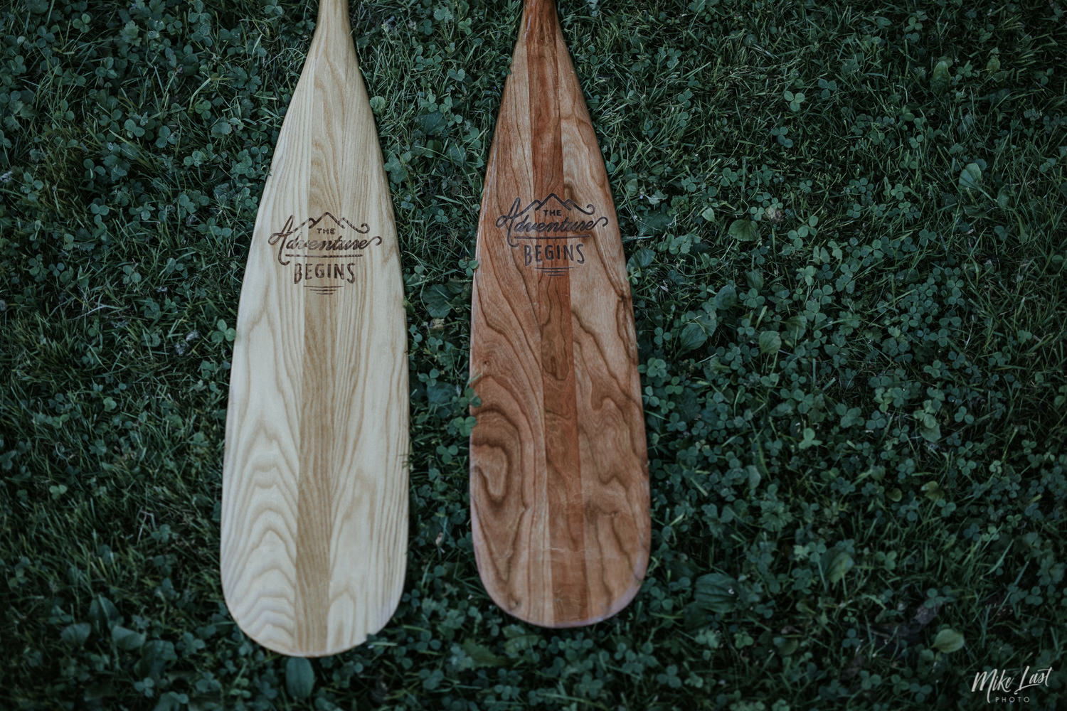 Bride and groom's matching wedding canoe paddles.
