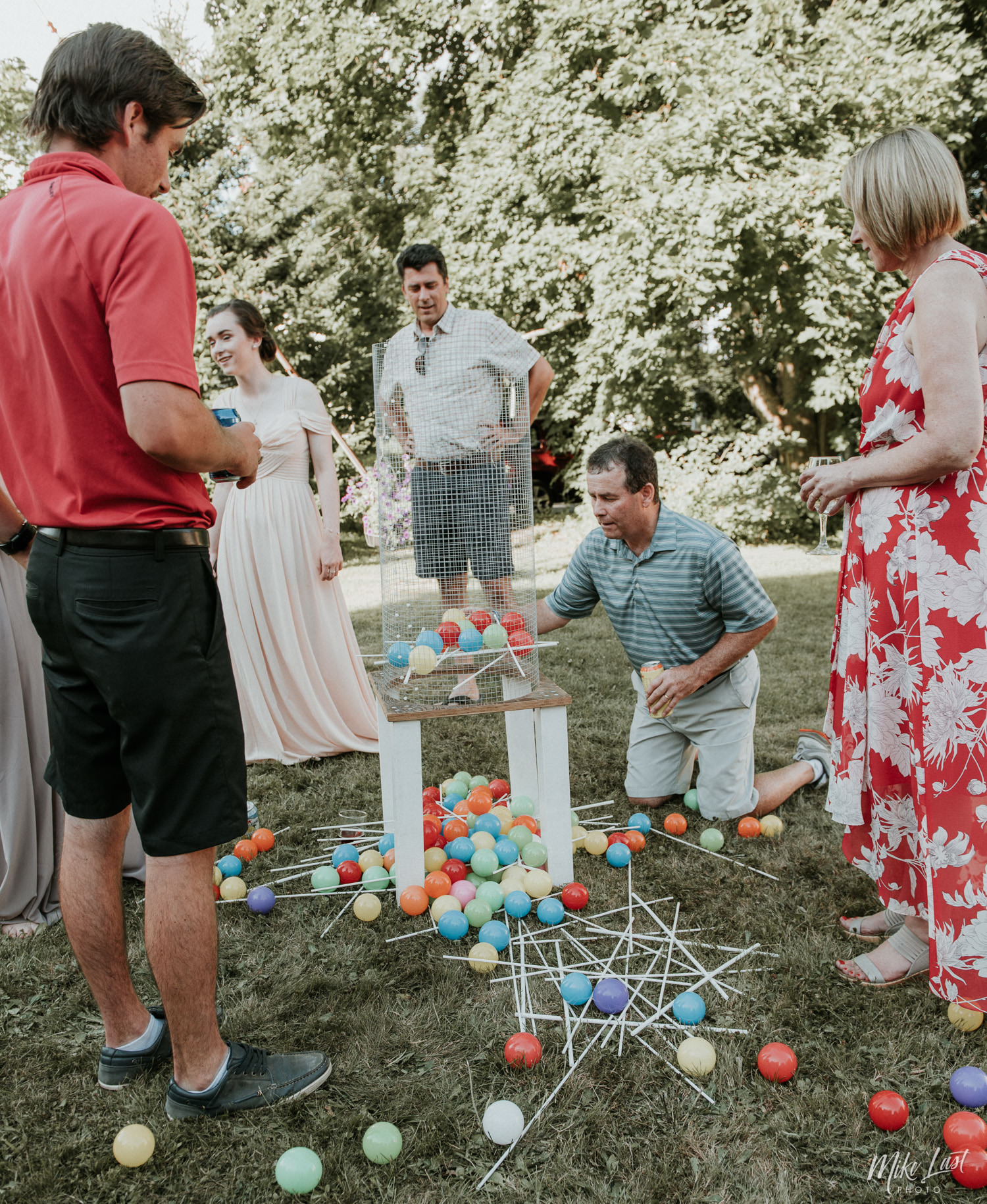 An adult-sized version of Kerplunk keeps guests entertained at wedding cocktail hour.
